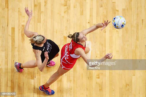 Joanne Harten of England is challenged by Katrina Grant of New Zealand during the 2015 Netball World Cup Semi Final 1 match between New Zealand and...