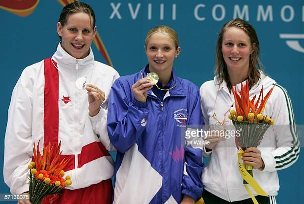 Joanne Jackson of England Caitlin McClatchey of Scotland and Bronte Barratt of Australia pose with their medals after the women's 400m freestyle...