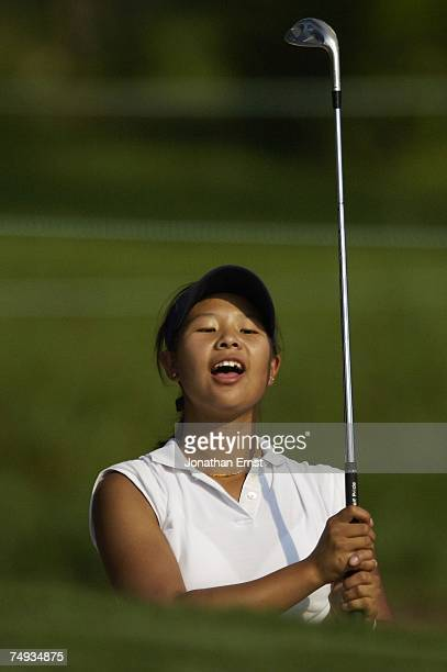 Joanne Lee watches her shot out of the sand to the third green in a practice round prior to the start of the US Women's Open Championship at Pine...