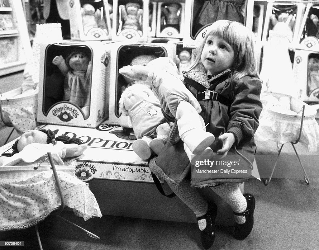 Joanne Lowe, aged 2, with her newly �adopted� doll. Britain �went bonkers� for the Cabbage Patch Kids, which were marketed as �adoptable�. �Shoppers fought to pay £24.99 for one of the pug-faced dolls as they went on sale at a handful of select stores. The craze has already caused riots in America with police being called in to control crowds.�