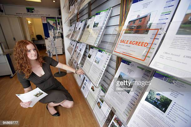 Joanne Malone estate agent sorts the latest property listings at Ulster Property sales on the Lisburn Road in south Belfast UK on Monday July 28 2008...