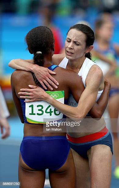 Joanne Pavey of Great Britain hug Marielle Hall of the United States after competing in the Women's 10000 metres final on Day 7 of the Rio 2016...