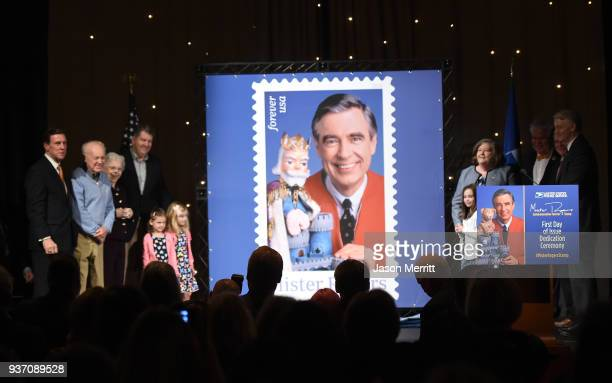 Joanne Rogers poses for a photo with other family members during the US Postal Service Dedication of the Mister Rogers Forever Stamp at WQED's Fred...