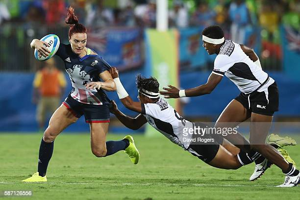 Joanne Watmore of Great Britain carries the ball under pressure from Lavenia Tinai of Fiji during the Women's Quarterfinal rugby match on Day 2 of...