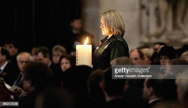 Joanne Wiggett a Paramedic with London Ambulance Service carries the Edgware Road candle at the National Memorial Service dedicated to victims of the...