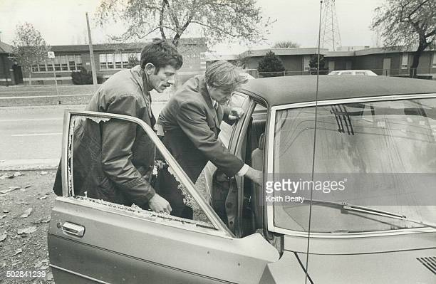 JoAnne Woodfine 10 describes her escape from a sniper's shotgun as police examine the pelletdamaged car she was riding in and bikers wait to get back...