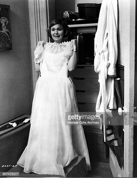 Joanne Woodward a psychiatrist holds up a white dress in a scene from the Universal Studios movie They Might Be Giants circa 1971