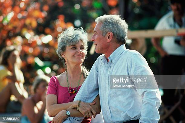 Joanne Woodward actress and wife of actor Paul Newman holds his arm while on set of film Harry Son