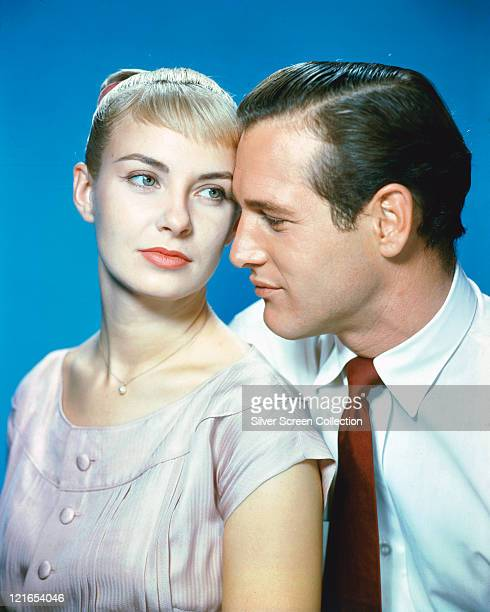 Joanne Woodward US actress and Paul Newman US actor in a studio portrait against a blue background issued as publcity for the film 'The Long Hot...