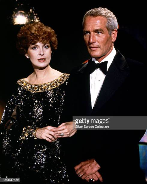 Joanne Woodward US actress wearing a black evening dress with gold trim and Paul Newman US actor wearing a black tuxedo with a white shirt and black...