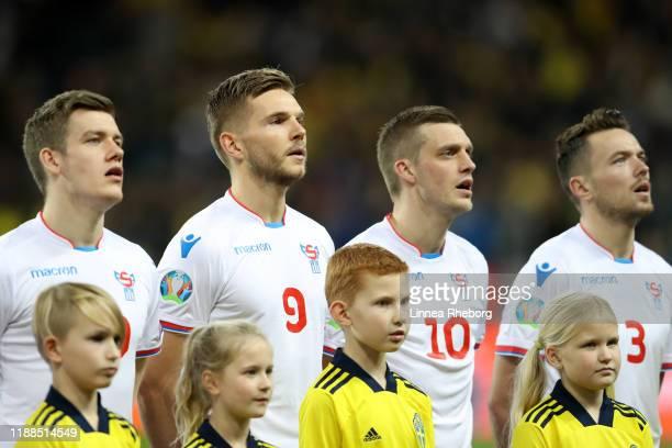 Joannes Bjartalio, Gilli Rolantsson, Solvi Vatnhamar and Viljormur Davidsen of Faroe Islands participate in the national anthem ahead of the UEFA...