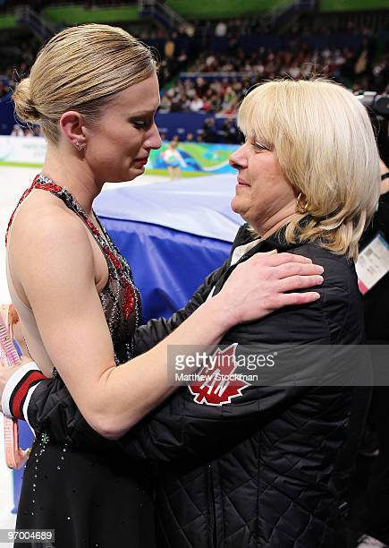 Joannie Rochette of Canada embraces her coach Manon Perron after competing in the Ladies Short Program Figure Skating on day 12 of the 2010 Vancouver...