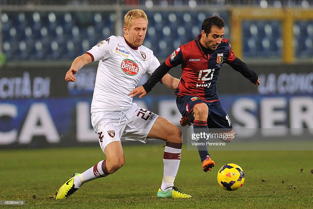 Joannis Fetfatzidis (R) of Genoa CFC is tackled by Kamil Glik of Torino FC during the Serie A match between Genoa CFC and Torino FC at Stadio Luigi Ferraris on November 30, 2013 in Genoa, Italy.
