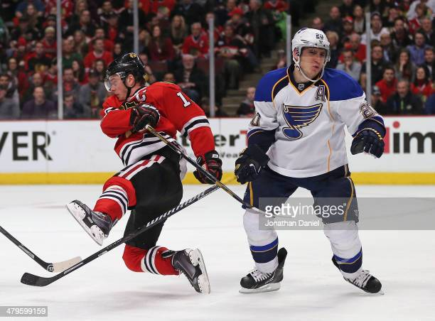 Joanthan Toews of the Chicago Blackhawks falls to the ice after colliding with the stick of Alexander Steen of the St. Louis Blues at the United...