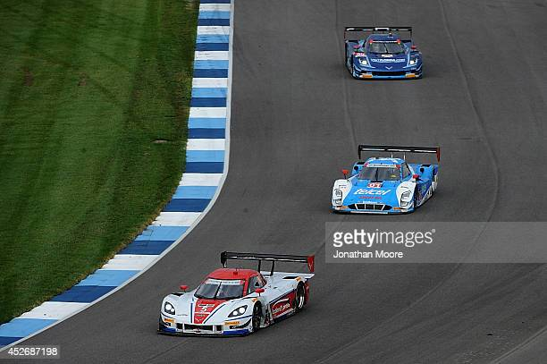 Joao Barbosa of Portugal and Christian Fittipaldi of Brazil drivers of the Action Express Racing Chevrolet Corvette DP followed by Scott Pruit and...