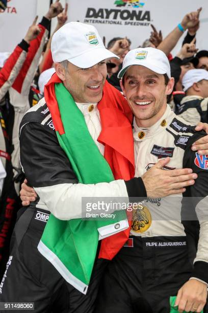 Joao Barbosa of Portugal and Felipe Albuquerque of Portugal celebrate in victory lane after winning the Rolex 24 at Daytona IMSA WeatherTech Series...