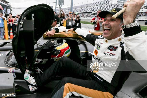 Joao Barbosa of Portugal celebrates as he rides with his teammates to victory lane after winning the Rolex 24 at Daytona IMSA WeatherTech Series race...