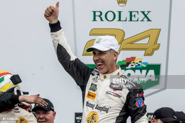 Joao Barbosa of Portugal celebrates in victory lane after winning the Rolex 24 at Daytona IMSA WeatherTech Series race at Daytona International...