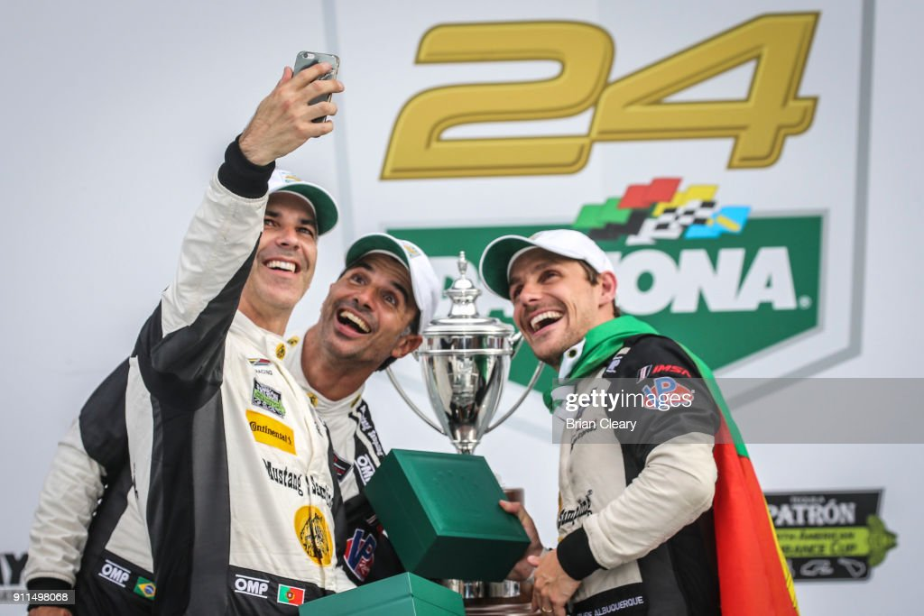 Joao Barbosa of Portugal Christian Fittipaldi of Brazil and Felipe Albuquerque of Portugal celebrate with Rolex watches in victory lane after winning the Rolex 24 at Daytona IMSA WeatherTech Series race at Daytona International Speedway on January 28, 2018 in Daytona Beach, Florida.