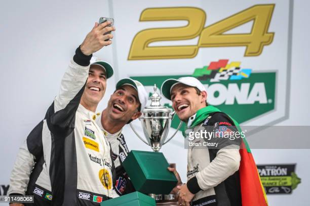 Joao Barbosa of Portugal Christian Fittipaldi of Brazil and Felipe Albuquerque of Portugal celebrate with Rolex watches in victory lane after winning...