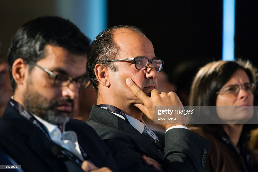 Joao Bento, president of Cotec, center, and Pedro Norton, chief executive officer of Impresa SGPS SA, left, sit and listen during a session at the IBM CEO Forum in Lisbon, Portugal, on Wednesday, Oct.17, 2012. Portuguese business confederation CIP said tax increases included in the government's 2013 budget proposal will result in a deeper contraction of the domestic market. Photographer: Mario Proenca/Bloomberg via Getty Images