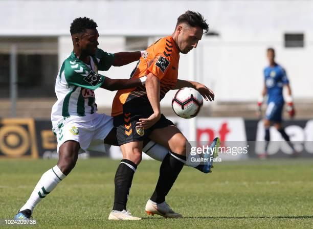 Joao Camacho of CD Nacional with Mano of Vitoria FC in action during the Liga NOS match between Vitoria FC and CD Nacional at Estadio do Bonfim on...