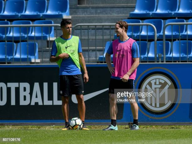 Joao Cancelo and Cristian Ansaldi of FC Internazionale chat during a training session at Suning Training Center at Appiano Gentile on August 22 2017...