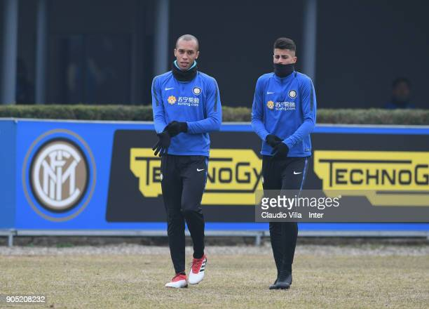 Joao Cancelo and Joao Miranda de Souza Filho of FC Internazionale chat during the FC Internazionale training session at Suning Training Center at...
