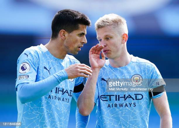 Joao Cancelo and Oleksandr Zinchenko of Manchester City in action during the Premier League match between Manchester City and Leeds United at Etihad...