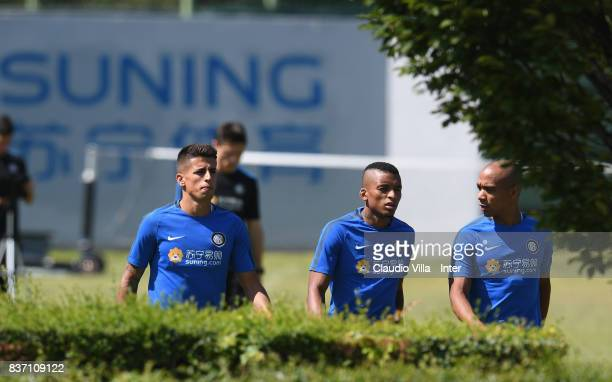 Joao Cancelo Dalbert Henrique Chagas Estevão and Joao Mario of FC Internazionale chat during a training session at Suning Training Center at Appiano...