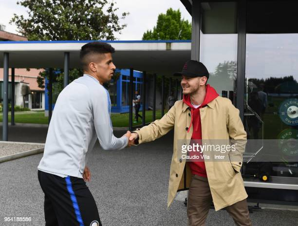 Joao Cancelo of FC Internazionale and Alessandro Cattelan pose for a photo during the FC Internazionale training session at the club's training...