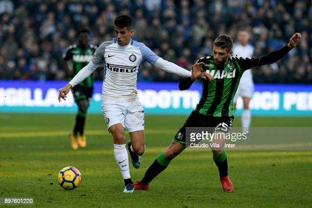 Joao Cancelo of FC Internazionale and Domenico Berardi of US Sassuolo compete for the ball during the serie A match between US Sassuolo and FC...
