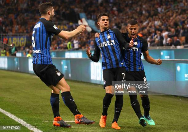 Joao Cancelo of FC Internazionale celebrates with teammates after scoring the opening goal during the serie A match between FC Internazionale and...