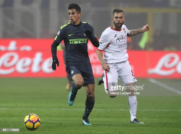Joao Cancelo of FC Internazionale competes for the ball with Salvatore Burrai of Pordenone during the TIM Cup match between FC Internazionale and...