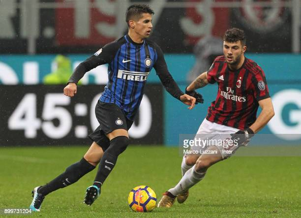 Joao Cancelo of FC Internazionale is challenged by Patrick Cutrone of AC Milan during the TIM Cup match between AC Milan and FC Internazionale at...