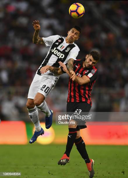 Joao Cancelo of Juventus and Patrick Cutrone of AC Milan compete for the ball during the Italian Supercup match between Juventus and AC Milan at King...