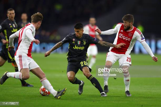 Joao Cancelo of Juventus is challenged by Lasse Schone of Ajax during the UEFA Champions League Quarter Final first leg match between Ajax and...