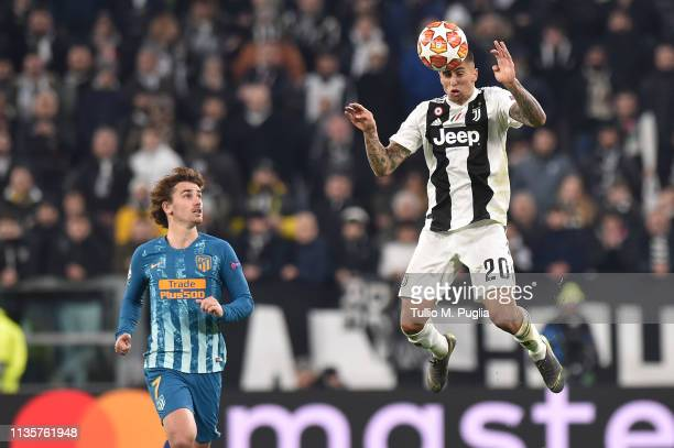 Joao Cancelo of Juventus jumps for a header as Antoine Griezmann of Atletico Madrid tackles during the UEFA Champions League Round of 16 Second Leg...