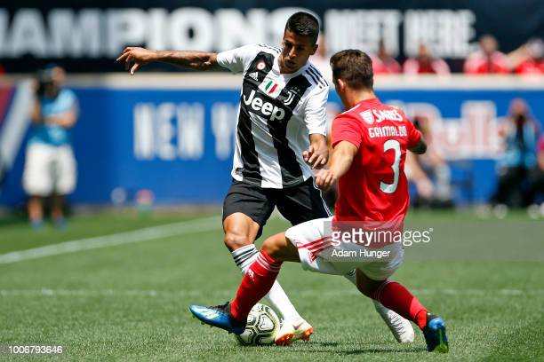 Joao Cancelo of Juventus loses the ball to Alejandro Grimaldo of Benfica during the International Champions Cup 2018 match between Benfica and...