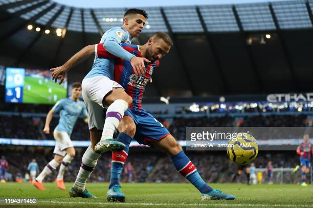 Joao Cancelo of Manchester City and Cenk Tosun of Crystal Palace during the Premier League match between Manchester City and Crystal Palace at Etihad...