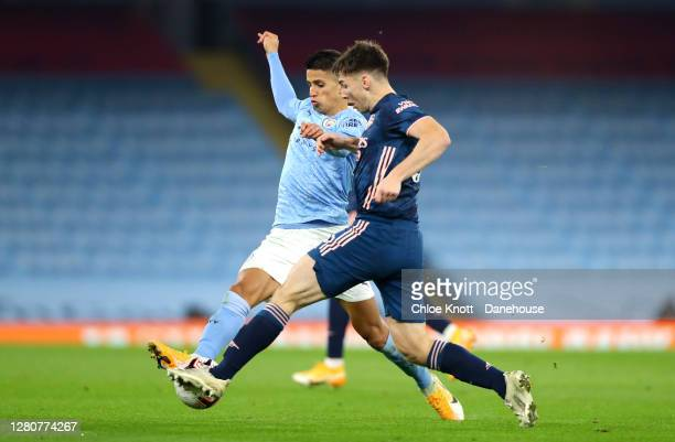 Joao Cancelo of Manchester City and Kieran Tierney of Arsenal in action during the Premier League match between Manchester City and Arsenal at Etihad...
