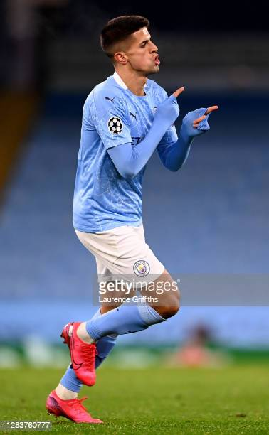 Joao Cancelo of Manchester City celebrates after scoring his sides third goal during the UEFA Champions League Group C stage match between Manchester...