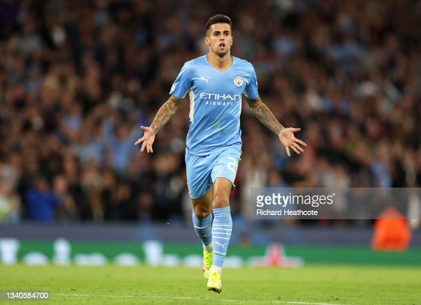 Joao Cancelo of Manchester City celebrates after scoring their side's fifth goal during the UEFA Champions League group A match between Manchester...
