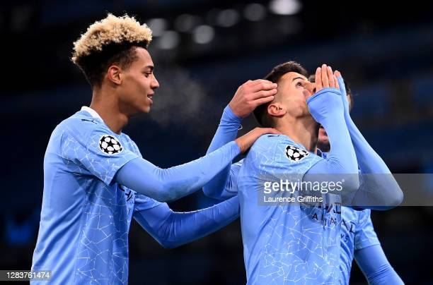 Joao Cancelo of Manchester City celebrates with Lukas Nmecha after scoring his sides third goal during the UEFA Champions League Group C stage match...