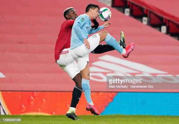 Joao Cancelo of Manchester City challenges Paul Pogba of Manchester United during the Carabao Cup Semi Final match between Manchester United and...