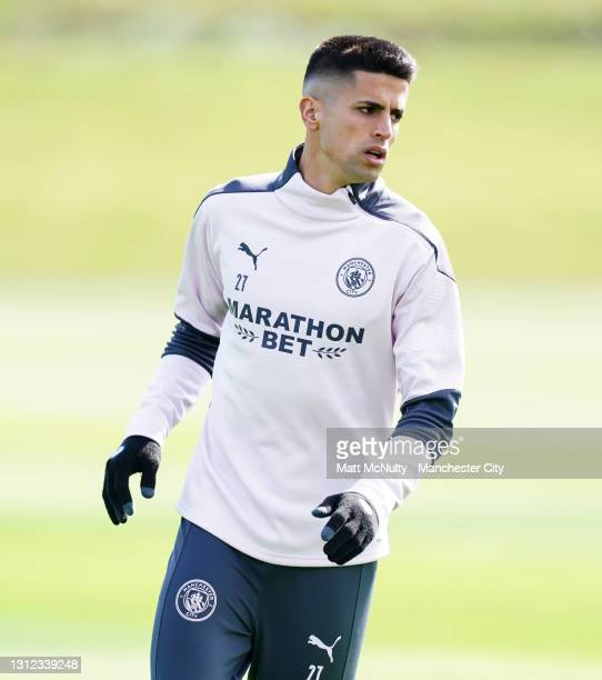 Joao Cancelo of Manchester City in action during a training session at Manchester City Football Academy on April 13, 2021 in Manchester, England.