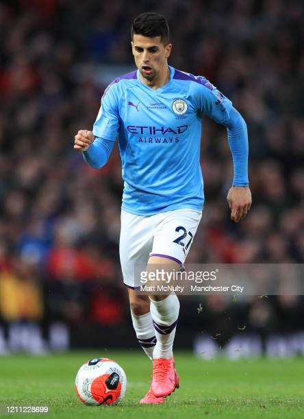 Joao Cancelo of Manchester City in action during the Premier League match between Manchester United and Manchester City at Old Trafford on March 08...