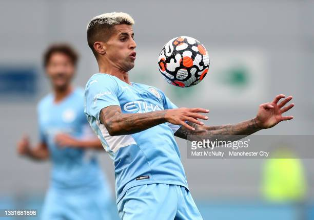 Joao Cancelo of Manchester City in action during the pre-season friendly match between Manchester CIty and Barnsley at Manchester City Football...