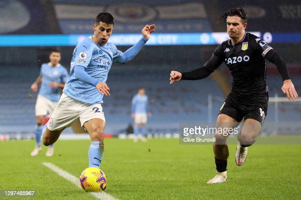 Joao Cancelo of Manchester City is challenged by Jack Grealish of Aston Villa during the Premier League match between Manchester City and Aston Villa...