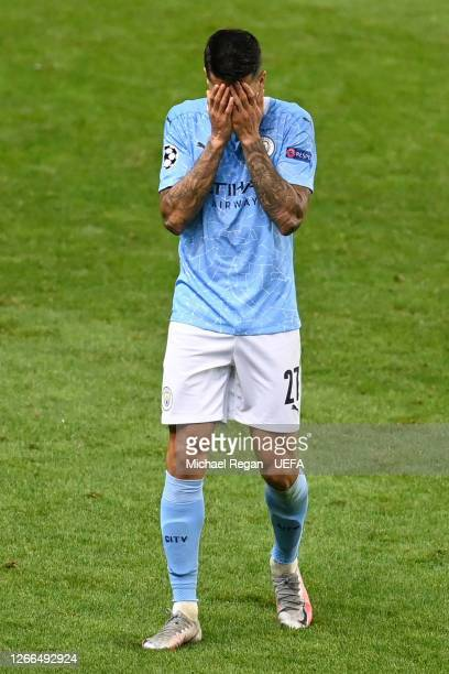 Joao Cancelo of Manchester City looks dejected following his team's defeat in the UEFA Champions League Quarter Final match between Manchester City...